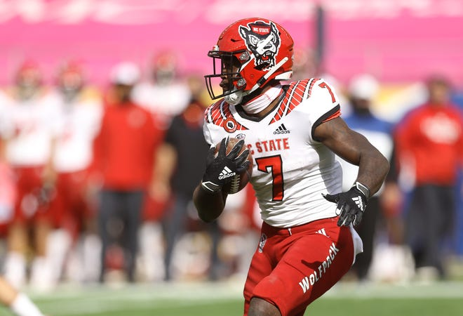 Oct 3, 2020; Pittsburgh, Pennsylvania, USA;  North Carolina State Wolfpack running back Zonovan Knight (7) runs the ball against the Pittsburgh Panthers during the fourth quarter at Heinz Field. The Wolfpack won 30-29. Mandatory Credit: Charles LeClaire-USA TODAY Sports
