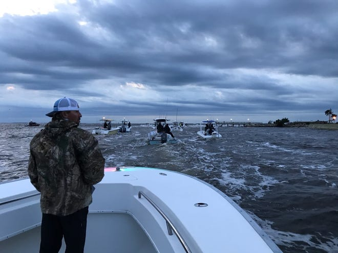 Curt Powell looks over the Southern Kingfish Association's US Open King Mackerel Fishing Tournament field as they blast off from the coast. More than 500 boats entered the tournament.