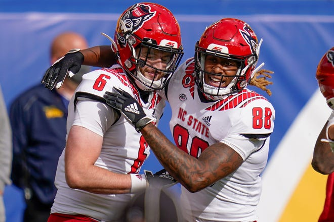 North Carolina State tight end Cary Angeline (6) celebrates with wide receiver Devin Carter (88) after making a touchdown catch against Pittsburgh during the second half of an NCAA college football game, Saturday, Oct. 3, 2020, in Pittsburgh. North Carolina State won 30-29. (AP Photo/Keith Srakocic)