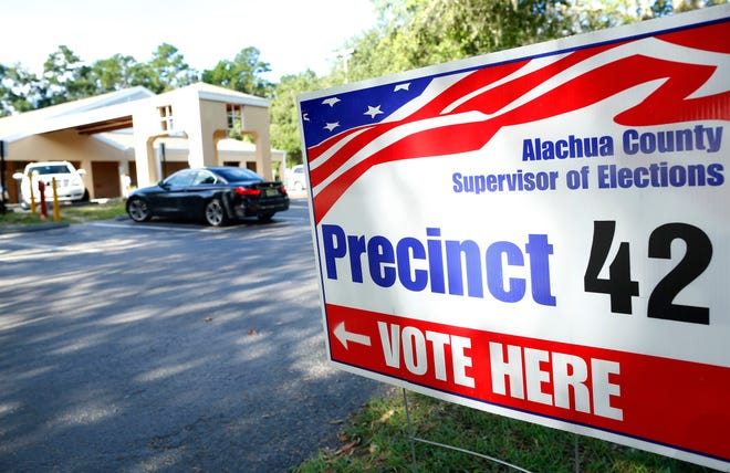 A voting sign sits outside the Tower Road Branch Library.