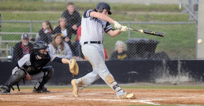 Gadsden City's Paden New slams a single March 10 during a high school baseball game against Fort Payne at Lindsey Field. The design phase has begun for a project to construct on-campus baseball and softball fields and possibly tennis courts at GCHS, and Superintendent Tony Reddick says 2021 could be the Titans' last baseball season at the field on Meighan Boulevard.