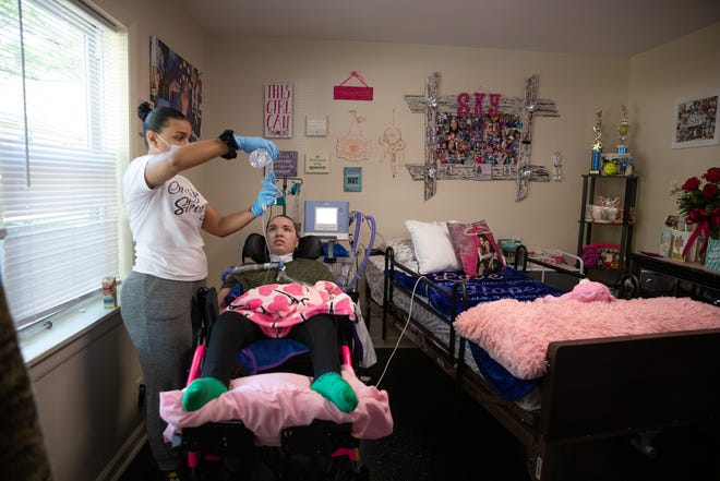 Lashanta Brown, left, feeds her daughter Sky Mendoza, right, though her feeding tube in Middletown on Oct. 5, 2020.