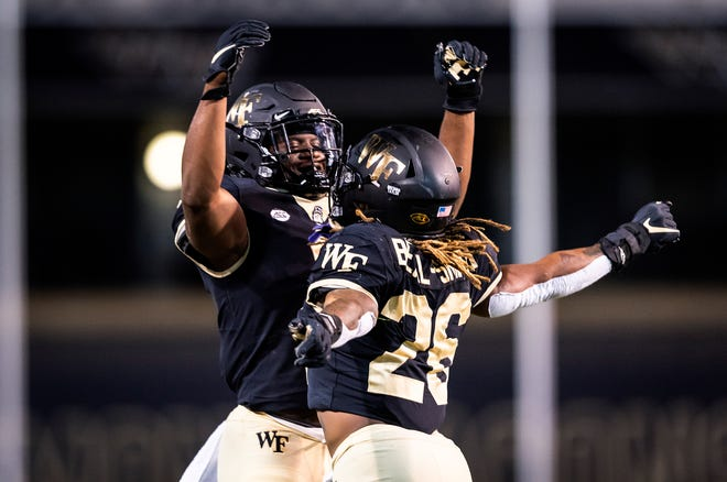 Wake Forest running back Christian Beal-Smith, right, celebrates his touchdown against Campbell with running back Kenneth Walker III last week.
