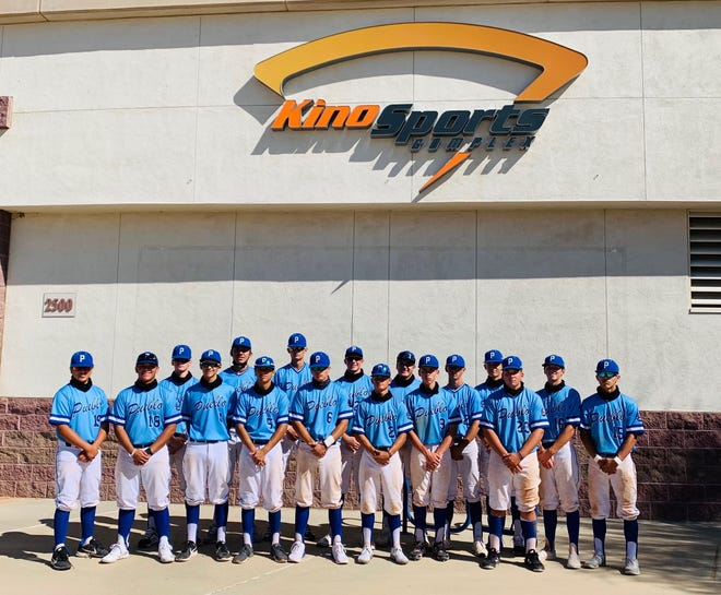 The Pueblo Baseball Mill poses in front of the Kino Sports Complex in Tucson, Arizona over the weekend.
