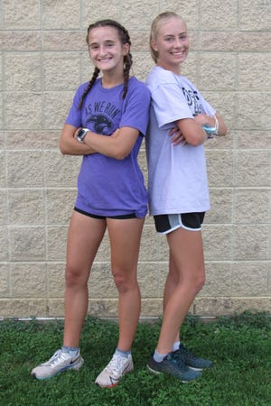 Emma Rittman, right, and Ashley Khatib had been the North girls cross country team's top two runners in all but one race during the past two seasons before the OCC-Ohio Division meet Oct. 17. Rittman, a junior, and Khatib, a sophomore, have been a dependable 1-2 tandem since middle school.
