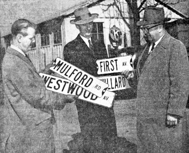 """Jule B. Keitz was a Grandview Heights mayor who ran and won election to the office in 1947 because of his stand on the issue of """"wrapped garbage."""" He appealed to residents to approve his program, saying, """"Grandview housewives can wrap garbage without costing the city or taxpayers one extra penny."""" After Keitz won the election, he proceeded to get an ordinance approved, making it illegal to place glass, metal or other injurious materials in garbage cans. After being sworn in Jan. 1, 1948, the new mayor wasted no time getting his pet projects accomplished. In this photo, Keitz is shown with Grandview businessmen Don Hennen and C.L. Deyo, who donated $1,180 to buy street signs for Grandview. In total, 175 signs were installed at intersections, where the names had been marked only on the curbsides. Keitz sought reelection four years later but lost to A.K. Pierce, who pledged, """"No city income tax, now or ever.""""Wrapped garbage no longer was the issue of the day."""