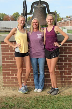 Running is more than a hobby for the Klamorick family, as evidenced by their success within the Canal Winchester cross country program. Coach Michelle Klamorick, center, is flanked by her two oldest daughters, senior Allena, left, and sophomore Marissa. Oldest son Reece, a 2020 graduate, also ran for the Indians. Two more siblings, fifth-grader Reide and fourth-grader Quinn, expect to run for the Indians in the future.