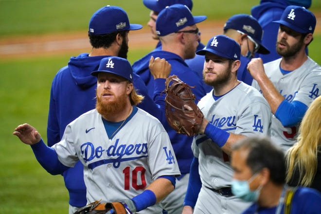 Dodgers' Justin Turner and teammates celebrate after defeating the San Diego Padres 12-3 in Game 3 of the National League Division Series on Thursday.