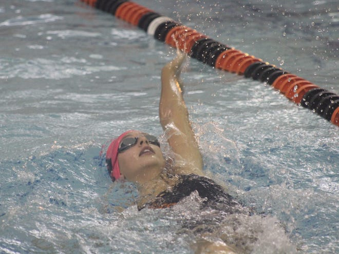 Wellsville's Hayden Waldon swims to a win in the 200 IM Thursday night against Livonia.