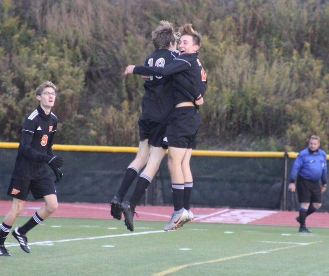 Aidan Riley (18) and Cody Costello (20) celebrate Riley's goal in Thursday night's 2-1 win over visiting Genesee Valley.