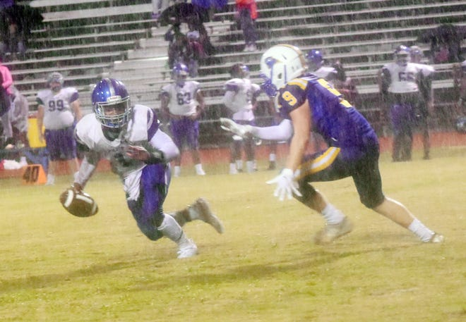 Buckeye's Hunter Derosia (9,right) puts pressure on Bolton's Jadarrius Welch (1, left) in a Thursday, Oct. 8, 2020 game held at Buckeye High School in Deville, La., between Buckeye and Bolton High School of Alexandria, La.. Bolton won 50-14. The game was moved up from Friday due to Hurricane Delta. The game was held even though there was heavy rainfall during the game.
