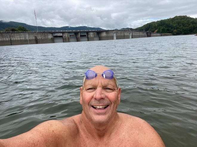 """Arden resident and Roberson High swim coach Jim """"Jimbo"""" Cottam swam 251 miles in September -- at least a 10k every day -- as a fundraiser for his brother-in-law and to raise awareness about brain cancer. In this photo he's near the dam at Fontana Lake."""