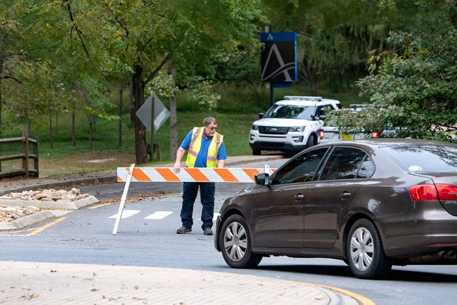 The entrances to UNC Asheville are blocked as the campus is locked down after a threat was made demanding the university paints over a Black Lives Matter mural on campus on Oct. 9, 2020.