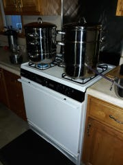 In this week's column Lovina shares about the process of juicing grapes with two large steamers, pictured.