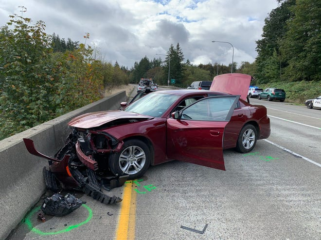 A maroon Dodge Charger crashed into the jersey barrier on Highway 16 Oct. 9, 2020, after a high-speed chase involving law enforcement. The car had entered the eastbound lane of the highway from Tremont Street going the wrong way. Two suspects fled on foot after the crash. One was apprehended.