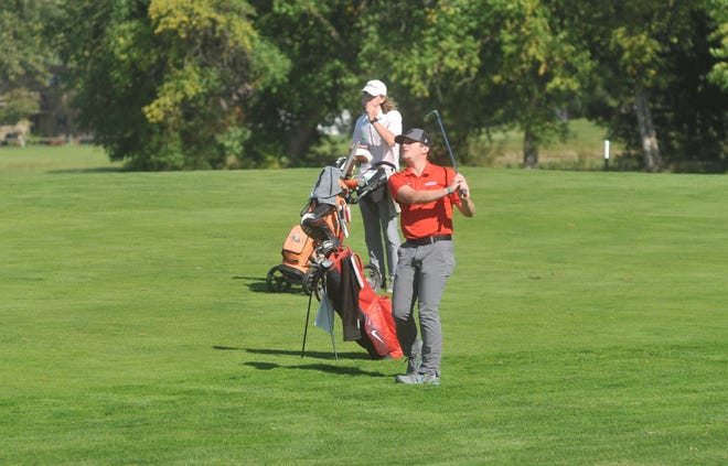 Buckeye Central's Tyler Rose hits an approach shot on the 15th hole at Stone Ridge Golf Club in the D-III district tournament.