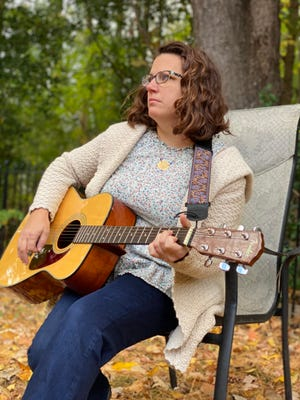 Trish Van Vliet strums the guitar as she contemplates her situation on Oct. 8, 2020. The Milton school teacher is facing termination for not being able to give the school a return to work date due to multiple surgeries and recovery time needed after an injury at school. She slipped on a puddle around a dehumidifier in the school hallway and injured her hip. She is awaiting a fourth and fifth surgery, including hip reconstruction. If she is terminated, she loses health insurance for herself and her three children.