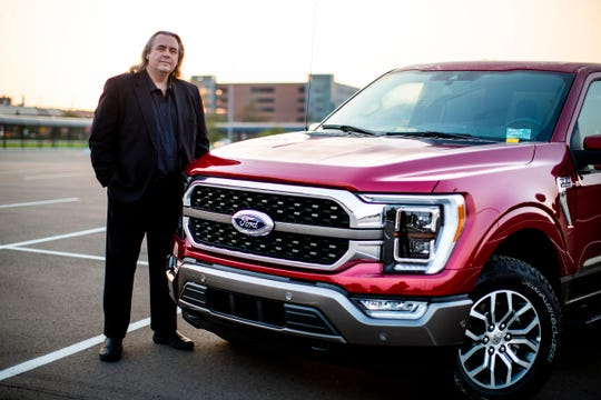 Mark Sich, design manager of the 2021 Ford F-150, stands next to the King Ranch in September.
