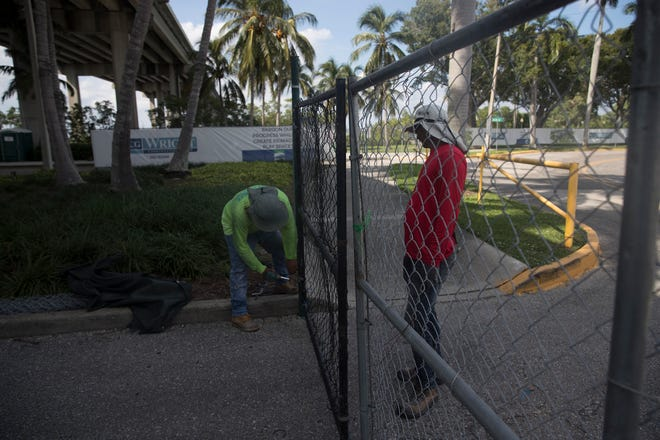 The remaining fencing is installed around Centennial Park on Thursday leaving the remaining homeless population in limbo.