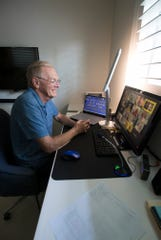 Cape Coral resident Gary Eidson participates in a video chat from his home with fellow computer club members.