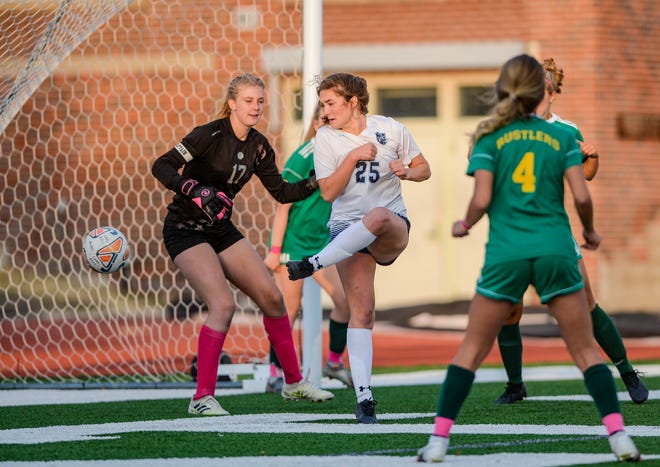 Great Falls High's Avrie Costley scores the first goal of Thursday's crosstown soccer match against CMR at Memorial Stadium.