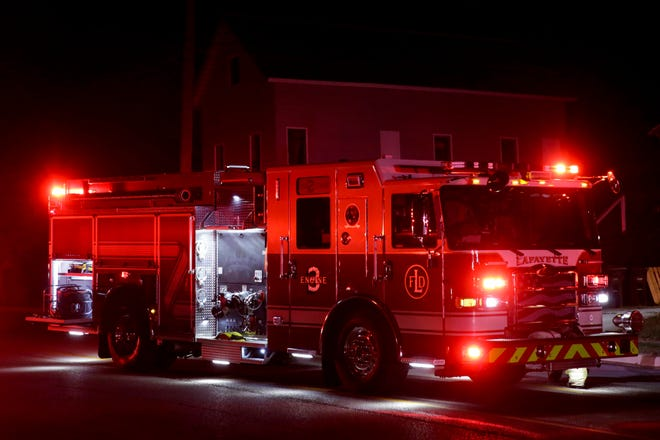 Lafayette Fire Department Engine 3 idles on 18th Street while responding to a structure fire, Thursday, Oct. 8, 2020 in Lafayette.