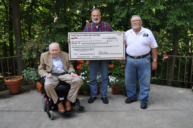 Dr. Edwin Payne, the Fairfield Center for disAbilities and Cerebral Palsy, left, poses with Steven Schaeffer and Lowell Bixler as the men present Dr. Payne a check. The men are members of the River Valley Rods and Customs Club, which had to disband this year after 32 years of fundraising for local non-profit organizations.