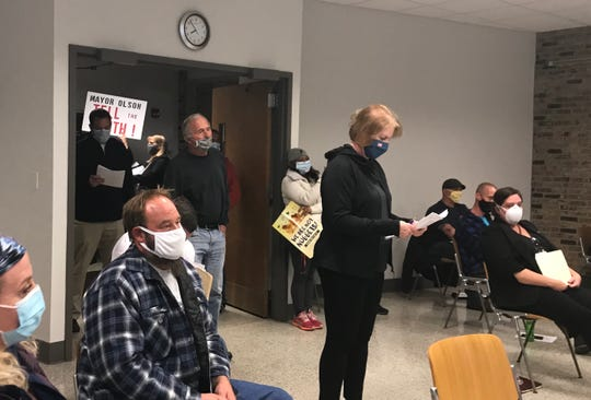 Residents, some with signs, packed three rooms in Franklin's city hall, and the lobby, during the Oct. 8 plan commission meeting. Many expressed concerns about a proposed Strauss Brands expansion in the city.