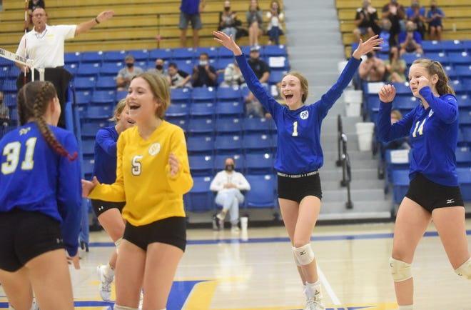 Mountain Home Junior Lady Bombers Lindsay Jensen (from left), Kiley Horne, Lakyn Beard, Carson Schmitz and Jordan Massie celebrate a point during their victory over Greene County Tech on Thursday night.