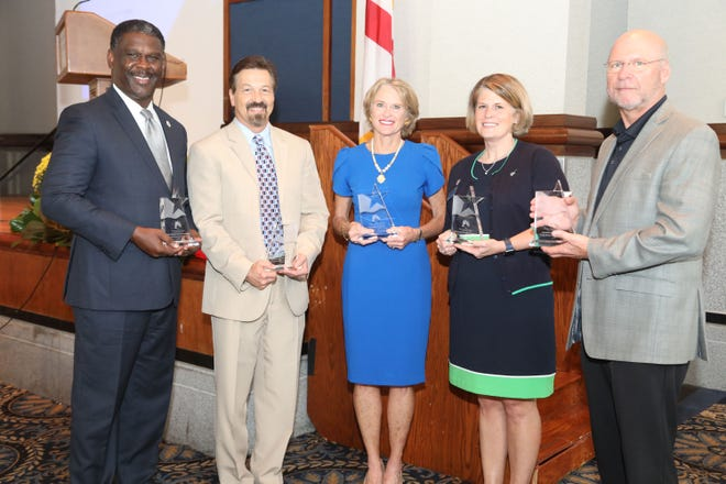 Winners of the annual River Region Ethics and Public Service Awards are honored Thursday in downtown Montgomery.