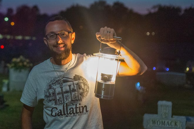 Director of Sumner County Museum Ryan Baker pauses for a photograph during the Candlelight Cemetery Tour presented by the Sumner County Museum at the Gallatin City Cemetery on Saturday evening, Oct. 3.