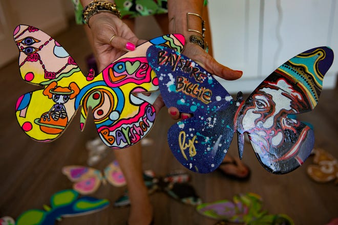 Amanda Jaron shows a pair of painted butterflies,Thursday, Oct. 8, 2020, at the Gasparilla Island House on Jeepers Drive in East Naples.