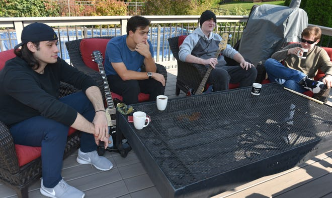 The Kings of Strings talk about their band during an October 9, 2020 get-together in Plymouth Township. From left are - Giovanni Rugiero (vocals), Jacob St. Pierre (guitar), Luke Porada (bass), and Noah Wojcik (drums).