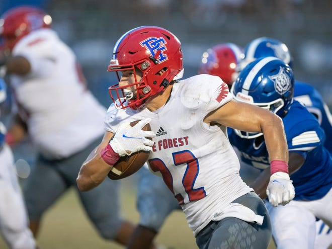 Gavin Grice (22) carries the ball during the Pine Forest vs Washington football game at Booker T. Washington High School in Pensacola on Thursday, Oct. 8, 2020.
