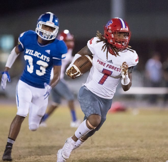 Keishawn Qualls (7) gets past Wildcat defenders during the Pine Forest vs Washington football game at Booker T. Washington High School in Pensacola on Thursday, Oct. 8, 2020.