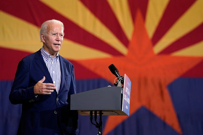 Democratic presidential candidate former Vice President Joe Biden speaks at the Carpenters Local Union 1912 in Phoenix on Oct. 8, 2020, to kick off a small-business bus tour.