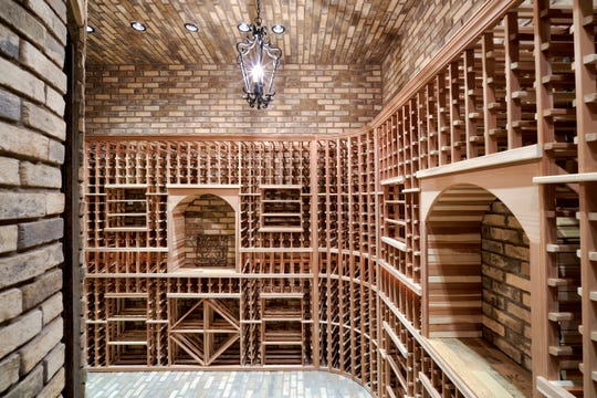 This $3.68M Scottsdale estate, sold by Michael and Robin Matzek, has a wine room that holds 1,000 bottles. Shikhar and Kristin Saxena were the buyers.