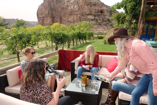 Visitors enjoy a wine tasting at the scenic Sutcliffe Vineyards in southwestern Colorado