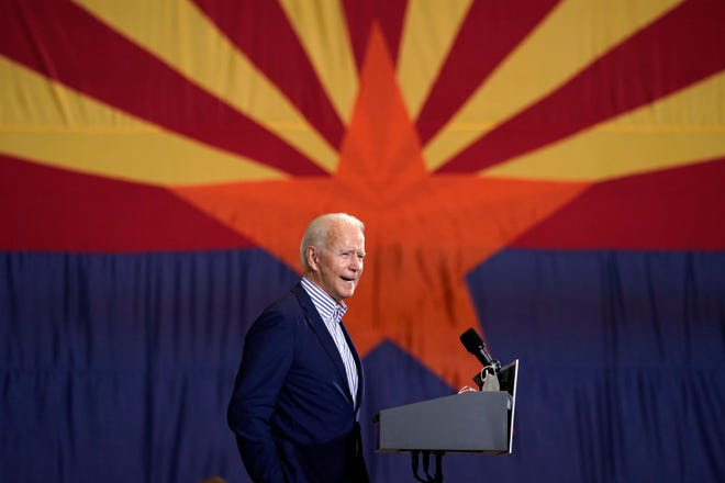 President-elect Joe Biden speaks at the Carpenters Local Union 1912 in Phoenix, Thursday, Oct. 8, 2020, to kick off a small business bus tour.
