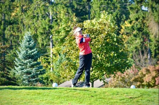 Port Huron Northern's Madison Bajis swings during the Division 2 girls golf regional Thuraday, Oct. 7, 2020, at Farmington Hills Golf Club.