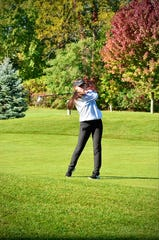 Port Huron Northern's Maddy Hemby swings during the Division 2 girls golf regional Thuraday, Oct. 7, 2020, at Farmington Hills Golf Club.