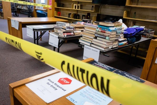 After books are returned, they're set aside in a quarantined area inside the library for several days before being returned to the shelves.