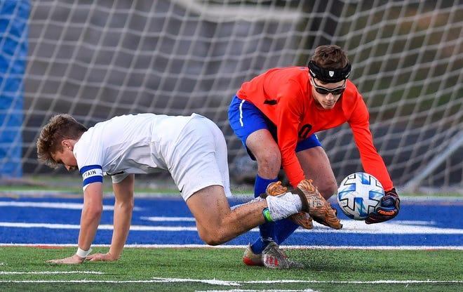 Dallastown's Zander Leik barely missing colliding with Spring Grove goal keep Mitch Aughenbaugh, Thursday, October 8, 2020. John A. Pavoncello photo