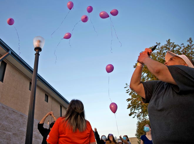 Balloons are released during the first scheduled event honoring National Domestic Violence Awareness Month in San Angelo on Thursday, Oct. 8, 2020.