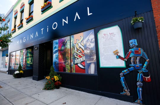 Greg Grace, who owns Imaginational on Commercial Street, created the historic figures in an effort to make the building down the street a little more appealing.