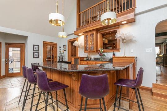 The bar is located in the addition created by previous owners. While architecturally seamless from the outside, the addition creates a vast space for entertaining.