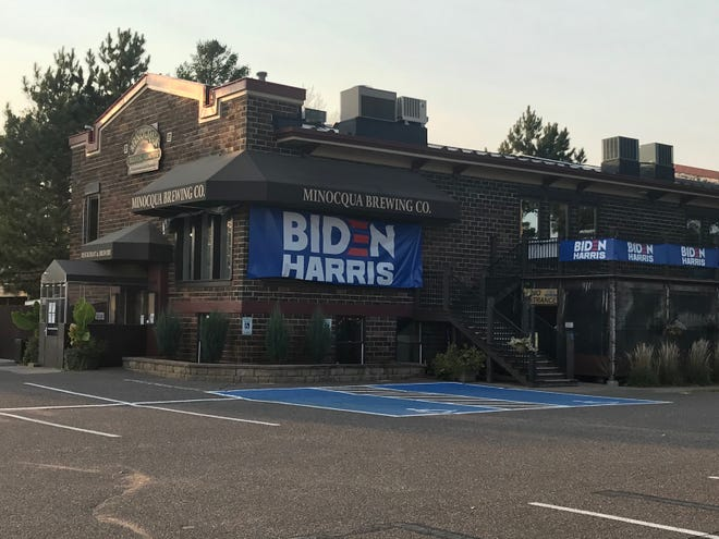 A campaign sign for Joe Biden and Kamala Harris on the side of Minocqua Brewing Co. has caused a stir in the race for Wisconsin's 34th Assembly District seat.
