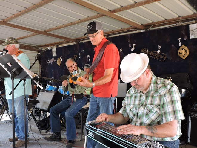 Jamming seamlessly Wednesday afternoon in downtown Turkey, diehard Western Swing musicians play classics of the genre plus some standard country songs for listeners and dancers at the 49th Annual Bob Wills Day in Turkey, Texas. The event goes into full swing on the weekend, but every year both musicians and fans begin crowding into Turkey early in the week. Playing steel guitar is Chappy Bressington of Hastings, Neb., transplanted from England. Texans make up the rest of the lineup: from left, Jay Gober singing and playing guitar, Grady Smith on fiddle, Wes Carter on drums and Larry Anderson playing bass. Out of the camera's range are Wayne Glasson on keyboard and Larry Lange on guitar. This year's event was originally slated for the last weekend in April. The COVID-19 pandemic prompted organizers to move the celebration to October 9-10.. A dance Friday and and an outdoor concert Saturday afternoon will feature the Bob Wills Texas Playboys under the direction of fiddle-player Jason Roberts with Billy Mata as lead vocalist. Bands led by Jake Hooker and Jody Nix will play for the Friday and Saturday dances, respectively. Also slated for Saturday are a 10 a.m. downtown parade, barbecue lunch at 11 a.m. and a fiddle contest at 11:30 a.m. Arts and crafts booths will be open both Friday and Saturday. For more information:  www.bobwillsday.com.