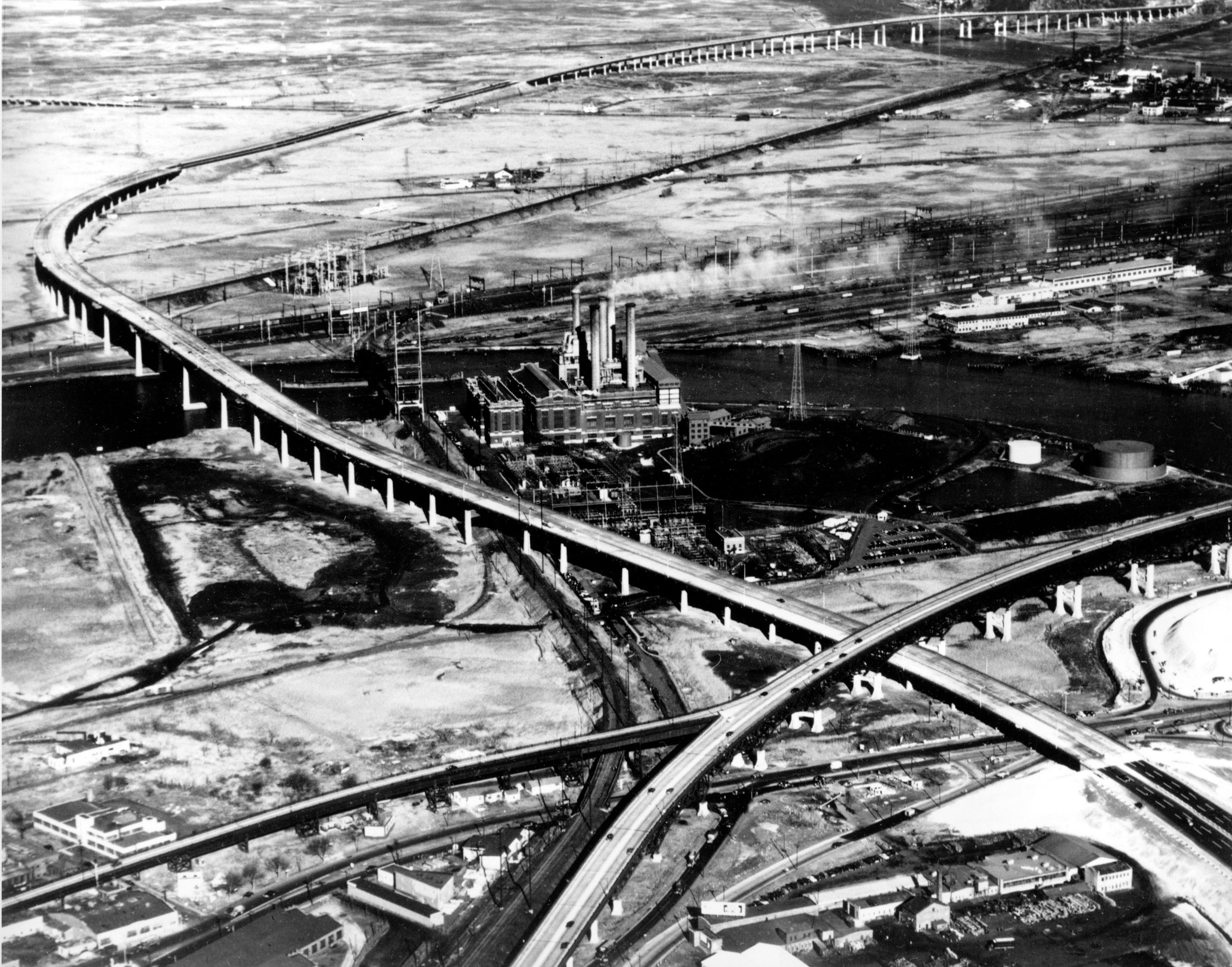 The New Jersey Turnpike crosses the Passaic River and underpasses the Pulaski Skyway in Newark, N.J., as seen in this 1952 aerial view.