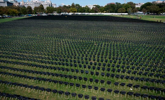 The empty chairs are displayed to represent the 200,000 lives lost to COVID-19 at the National Covid-19 Remembrance, on the ellipse behind the White House in Washington, DC on October 4, 2020.